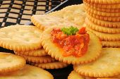picture of piquillo pepper  - Golden wheat crackers with bruschetta and a sprig of parsley - JPG