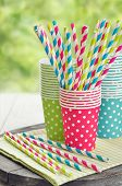 stock photo of tumbler  - Colorful paper cups and striped straws for birthday party - JPG