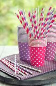 image of tumblers  - Colorful paper cups and striped straws for birthday party - JPG