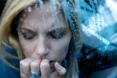 picture of bad mood  - Unhappy Depressed Woman in a car with water drops - JPG