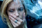 foto of bad mood  - Unhappy Depressed Woman in a car with water drops - JPG