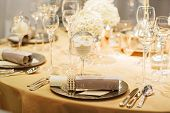 picture of wedding table decor  - Elegant table set in soft creme for wedding or event party - JPG