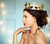 stock photo of queen crown  - Portrait of a beautiful young model in the crown - JPG