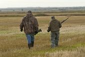 pic of hunt-shotgun  - A pair of hunters out in a field