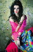 foto of harem  - Young woman with long dark hair and in east costume