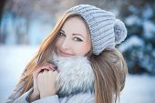 stock photo of cold-shoulder  - beautiful winter portrait of beautiful woman with hat - JPG