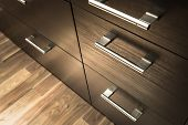 picture of wardrobe  - a wooden wardrobe drawer front metal handle - JPG