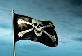 foto of skull crossbones flag  - Pirate skull and crossbones flag waving in the evening - JPG