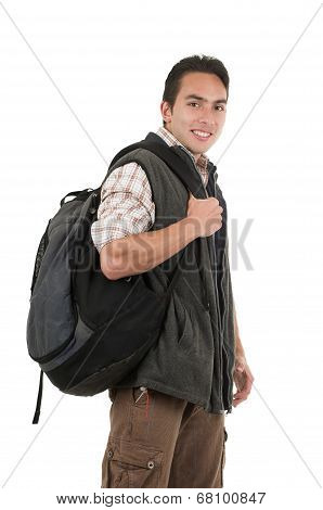 handsome latin young man wearing backpack and vest