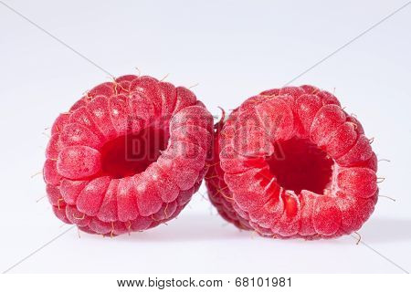two red rasberries isolated on white background