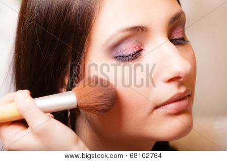 Makeup Artist Applying With Brush Powder Rouge On Female Check