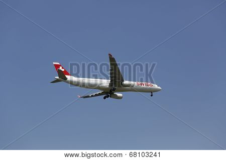 Swissair Airbus A330 in New York sky before landing at JFK Airport