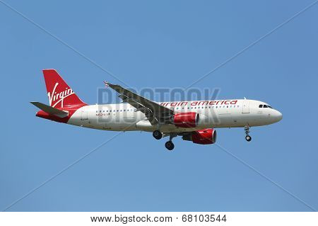 Virgin America Airbus A320 in New York sky before landing at JFK Airport