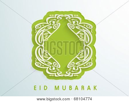 Arabic islamic calligraphy of text Eid Mubarak on green sticky for muslim community festival celebrations.