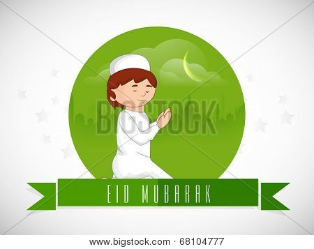 Religious cute muslim boy praying in crescent moon light for Muslim community festival Eid Mubarak celebrations.