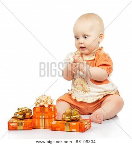 Joyful baby with gifts