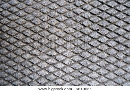 Cement Grid Indent On Asphalt