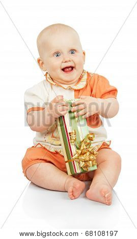 Happiness child keeps gift box