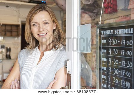 Owner Of Gift Shop Standing In Doorway