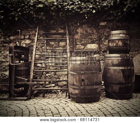 Old Traditional Wine Press And Oak Barrels