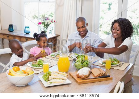 Happy family enjoying a healthy meal together at home in the kitchen