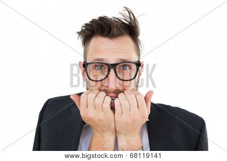 Geeky nervous businessman looking at camera on white background