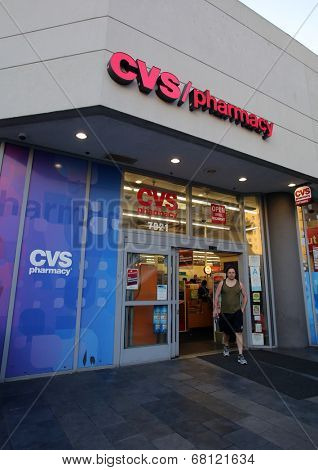 HOLLYWOOD, CALIFORNIA - TUES. JUNE 24, 2014: Pedestrians walk past a CVS drug store in Hollywood, California, on Sunday, June 29, 2014. CVS is the retail division of CVS Caremark