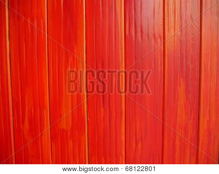 Background of vertical wooden panels painted red