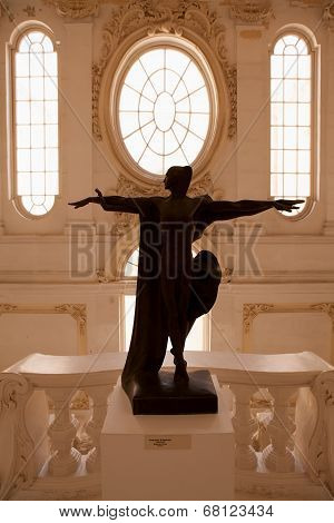 VALLETTA, MALTA - MAY 11 2014 : A lady statue presides over the stairway in the Museum of Fine Arts