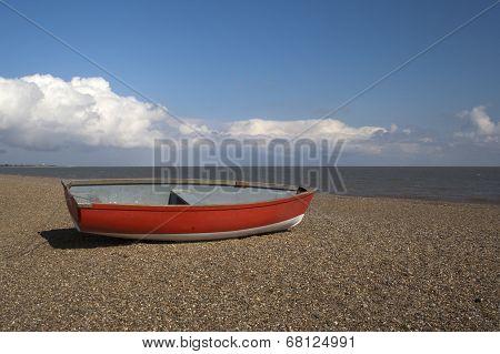 Red Boat On Dunwich Beach, Suffolk, England