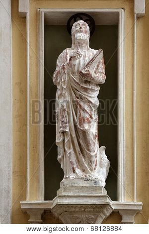 PORTOFERRAIO, ELBA, ITALY - MAY 03, 2014: St. John the Evangelist on the facade of the Church of Mercy in Portoferraio, Island of Elba, Tuscany, Italy on May 03, 2014