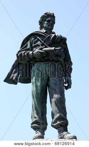PARMA, ITALY - MAY 01,2014: statue of a soldier War Memorial. Parma is famous for its ham, cheese and architecture. It is home to the University of Parma, one of the oldest universities in the world.