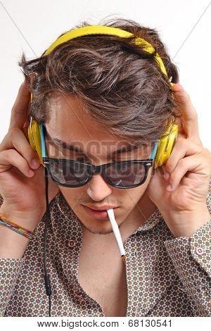 Young man wearing headphones,The deejay.