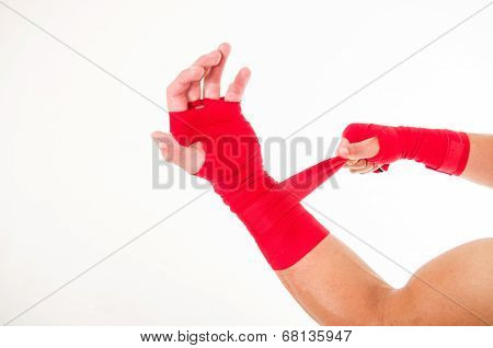 boxer's arm with red wristband around it