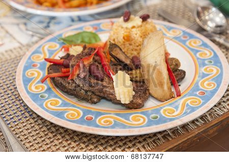 A La Carte Steak Meal On Patterned Plate