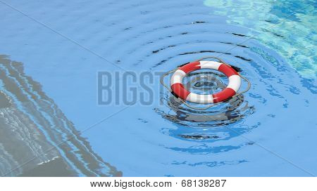 Lifebuoy floating in a clear pool water