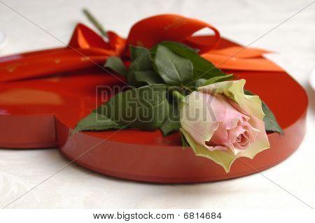 Chocolates box and rose