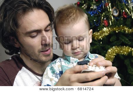 Father and son play with toys