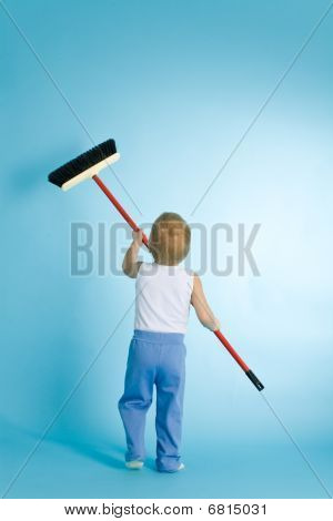 Little Boy With Cleaning Swab Over Blue