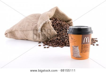 Ankara, Turkey - June 07, 2012: McDonalds coffee cup McCafe in front of sack of coffee beans isolated on white background