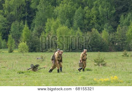 Soldiers Walk With Maxim Machine Gun