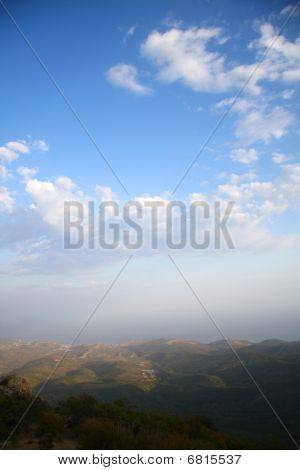 Mountainous landscape with cloudy sky