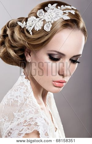 Portrait of a beautiful blonde woman in a wedding dress in the image of the bride.