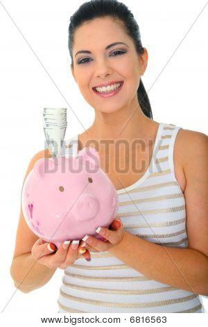 Smiling Mom Holding Piggy Bank