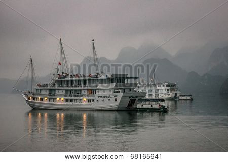 Cruise Junk Boat Sits Under Early Morning Fog.