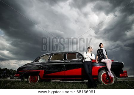 Young couple next retro car