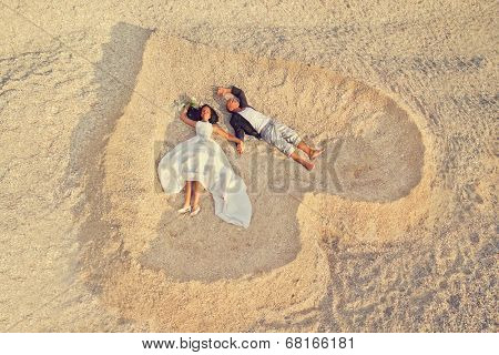 Beach wedding of happy newlywed couple