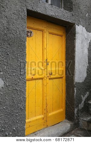 RIOMAGGIORE, ITALY - MAY 02, 2014: Brightly color door in Riomaggiore, one of the Cinque Terre villages, UNESCO World Heritage Sites, Riomaggiore, Liguria, Italy, on May 02, 2014