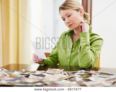 Woman Looking At Photos