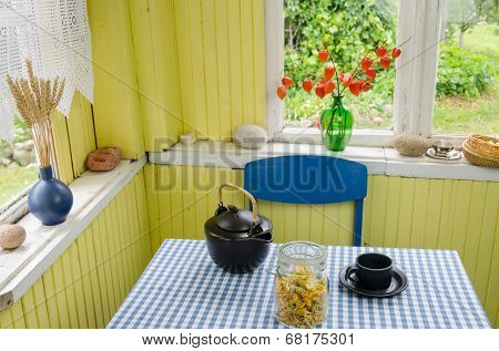 Rural Room And Ceramic Tea Set Calendula On Table